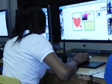 Students practice graphic design in a professional context - designing for real businesses.