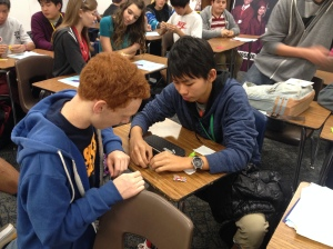 Japanese Students teach American Students how to make Origami Cranes.