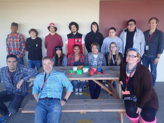 Students and educators pose with 3D printed objects.