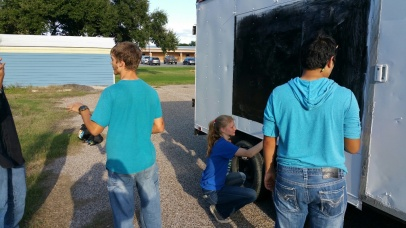 Students of the science club get busy painting the mobile observatory's exterior in the new color scheme.