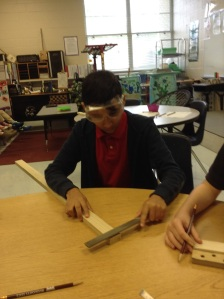 Students build cigar box guitars (Project photo).